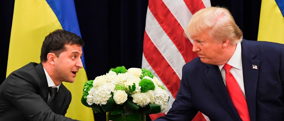 U.S. President Donald Trump and Ukrainian President Volodymyr Zelensky shake hands during a meeting in New York on Sept. 25, 2019. (SAUL LOEB/AFP via Getty Images)