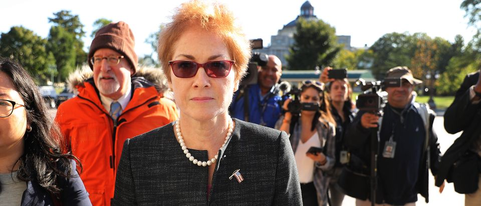 Former U.S. Ambassador to Ukraine Marie Yovanovitch (C) is surrounded by lawyers, aides and journalists as she arrives at the U.S. Capitol Oct. 11, 2019 in Washington, D.C. (Chip Somodevilla/Getty Images)