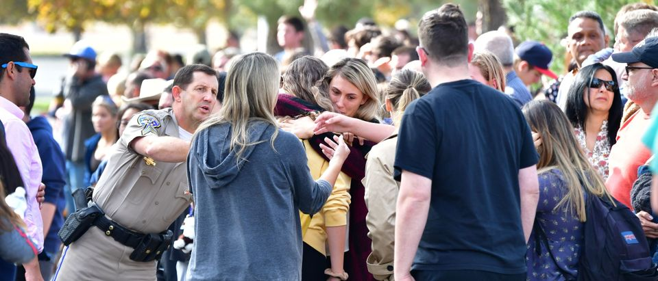 Grieving students from Saugus High School reunite with their parents at Central Park in Santa Clarita, California, on November 14, 2019. (FREDERIC J. BROWN/AFP via Getty Images)
