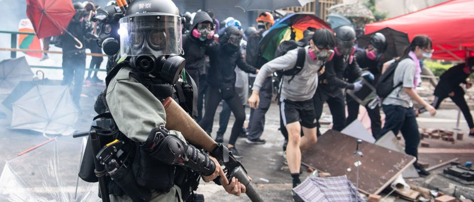 Police chase anti-government protesters at Hong Kong Polytechnic University on November 18, 2019 in Hong Kong, China. (Laurel Chor/Getty Images)