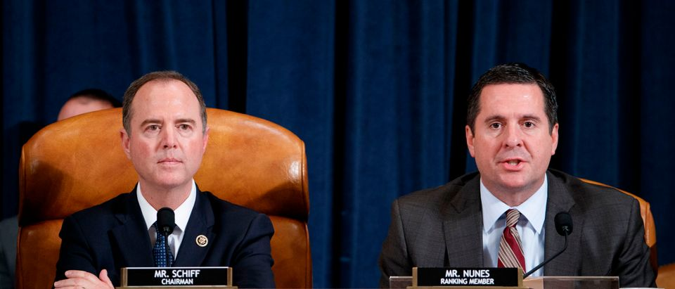 Ranking member of the House Permanent Select Committee on Intelligence Devin Nunes (R), with Democratic Chairman of the House Permanent Select Committee on Intelligence Adam Schiff (L), delivers his closing remarks. (SHAWN THEW/POOL/AFP via Getty Images)