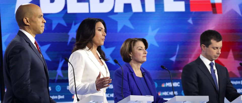 Sen. Cory Booker (L), Sen. Amy Klobuchar (2nd R) and South Bend, Indiana, Mayor Pete Buttigieg listen as Rep. Tulsi Gabbard (2nd R) speak during the Democratic presidential debate at Tyler Perry Studios Nov. 20, 2019 in Atlanta, Georgia. (Alex Wong/Getty Images)