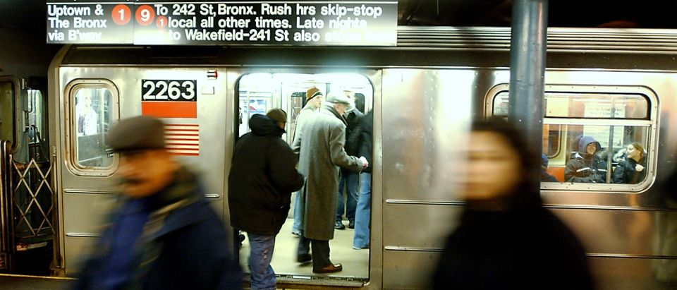 People get on a 1/9 subway at 50th Street Dec. 16, 2002 in New York City. Negotiations between the Transit Worker's Union and the Metropolitan Transportation Authority continue with the strike still on hold. (Photo by Stephen Chernin/Getty Images)