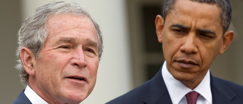 US President Barack Obama (R) listens as former US President George W. Bush speaks about relief efforts following the earthquake in Haiti, during a statement in the Rose Garden of the White House in Washington, DC, on January 16, 2010. (SAUL LOEB/AFP via Getty Images)