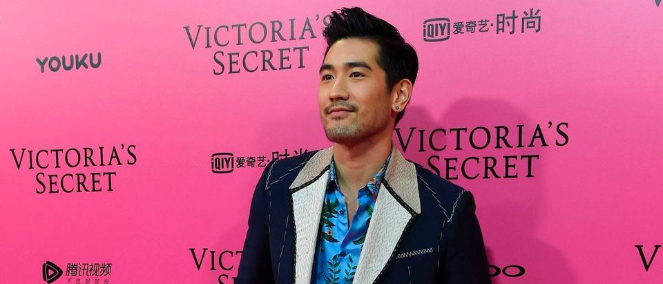 """Canadian actor Godfrey Gao a.k.a. Godfrey Tsao poses on the """"Pink Carpet"""" ahead of the start of the 2017 Victoria's Secret Fashion Show in Shanghai on November 20, 2017. / (Photo: CHANDAN KHANNA/AFP via Getty Images)"""