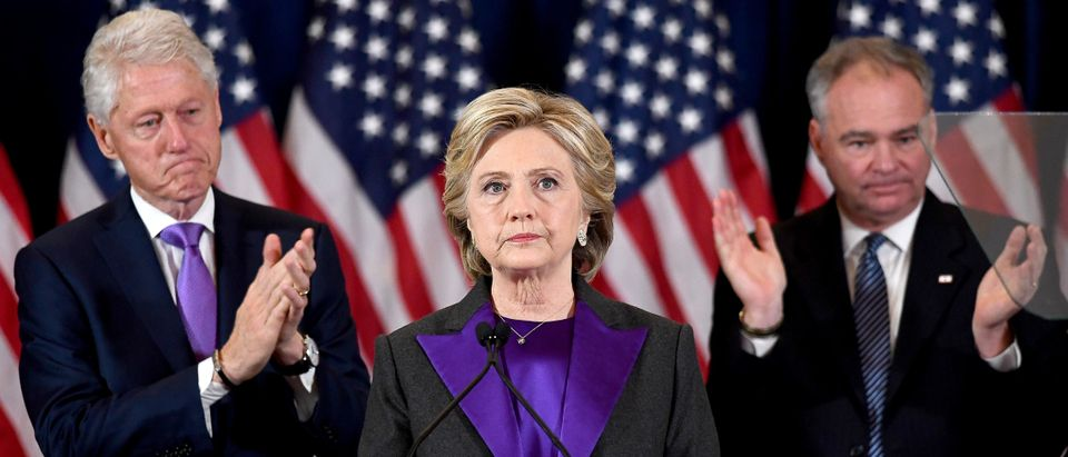 US Democratic presidential candidate Hillary Clinton makes a concession speech after being defeated by Republican presidential-elect Donald Trump as her running-mate Tim Kaine(R) and former president Bill Clinton look on in New York on November 9, 2016. (JEWEL SAMAD/AFP via Getty Images)