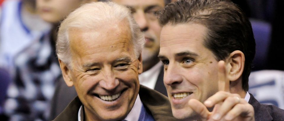 U.S. Vice President Joe Biden and his son Hunter Biden attend an NCAA basketball game between Georgetown University and Duke University in Washington, U.S., January 30, 2010. Picture taken January 30, 2010. REUTERS/Jonathan Ernst