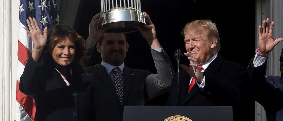 US President Donald Trump and US First Lady Melania Trump attend a ceremony with manager Dave Martinez(C) to welcome the 2019 World Series Champions, the Washington Nationals on the South Lawn of the White House in Washington, DC, November 04, 2019. (Photo by OLIVIER DOULIERY/AFP via Getty Images)