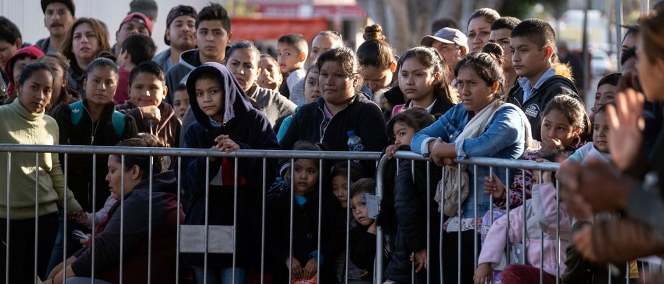 Asylum seekers gather as they look for an appointment date with U.S. authorities outside El Chaparral crossing port on the U.S.-Mexico border in Tijuana, Baja California state, Mexico, on Oct. 18, 2019. (Photo: GUILLERMO ARIAS/AFP via Getty Images)