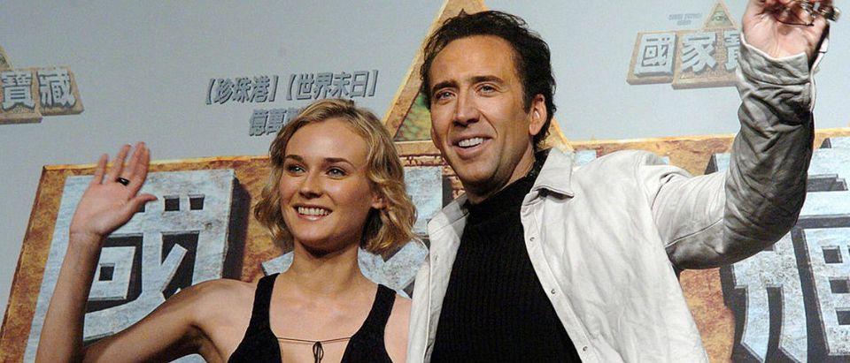 Hollywood actors Nicolas Cage (R) and Di
