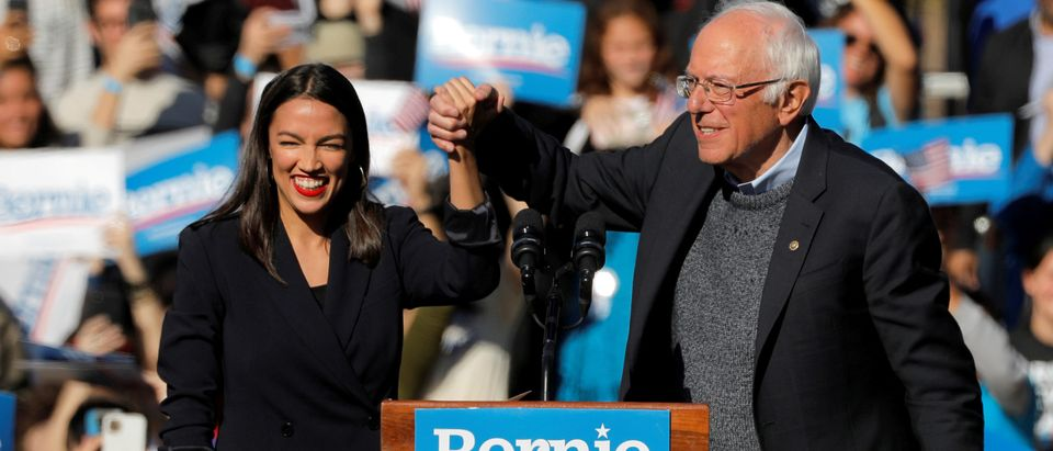 "U.S. Rep. Alexandria Ocasio-Cortez introduces Democratic 2020 U.S. presidential candidate and U.S. Sen. Bernie Sanders during the ""Bernie's Back"" rally at Queensbridge Park in the Queens Borough of New York City, U.S., Oct. 19, 2019. REUTERS/Andrew Kelly"