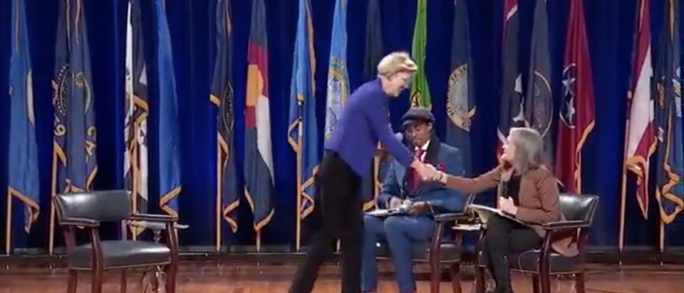 Elizabeth Warren shakes Amy Goodman's hand after environmental justice forum (Twitter Screenshot)