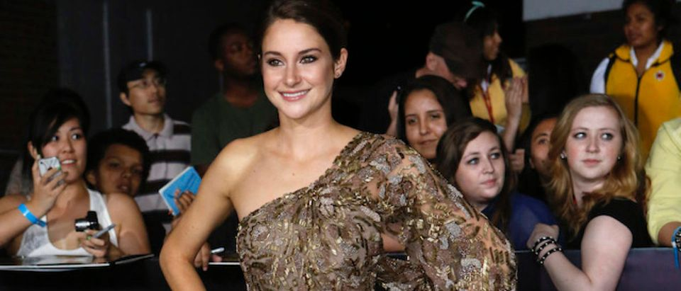 "Shailene Woodley poses at the premiere of ""Divergent"" in Los Angeles"