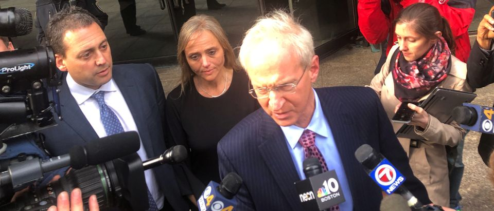 Massachusetts District Court Judge Shelley Joseph (2nd L) stands beside her lawyer, Thomas Hoopes as he speaks to reporters outside of the federal courthouse in Boston, Massachusetts, U.S., April 25, 2019. REUTERS/Nate Raymond
