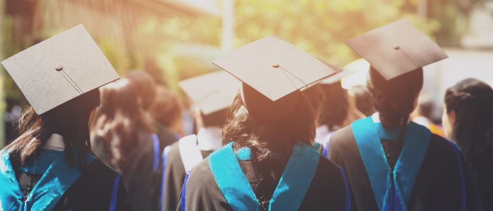 A shot of graduation hats during commencement is pictured. Shutterstock