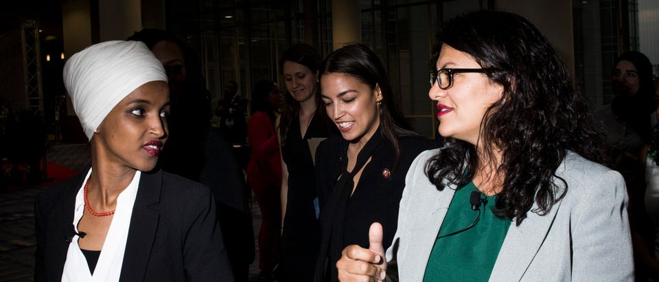 Rep. Ilhan Omar, Rep. Alexandria Ocasio-Cortez and Rep. Rashida Tlaib arrive before participating during a town hall hosted by the NAACP on Sept. 11, 2019 in Washington, D.C. (Photo by Zach Gibson/Getty Images)
