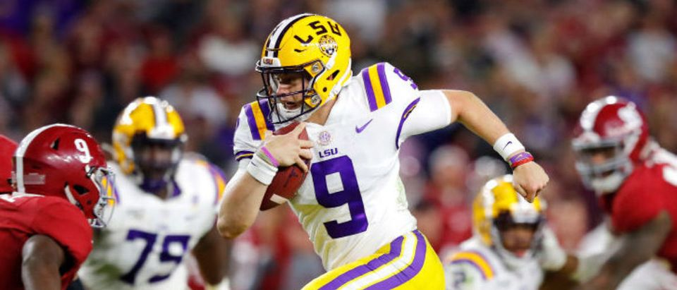 TUSCALOOSA, ALABAMA - NOVEMBER 09: Joe Burrow #9 of the LSU Tigers runs with the ball during the second half against the Alabama Crimson Tide in the game at Bryant-Denny Stadium on November 09, 2019 in Tuscaloosa, Alabama. (Photo by Kevin C. Cox/Getty Images)