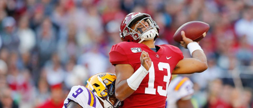 TUSCALOOSA, ALABAMA - NOVEMBER 09: Tua Tagovailoa #13 of the Alabama Crimson Tide is hit by Marcel Brooks #9 of the LSU Tigers as he throws the ball during the first half in the game at Bryant-Denny Stadium on November 09, 2019 in Tuscaloosa, Alabama. (Photo by Kevin C. Cox/Getty Images)