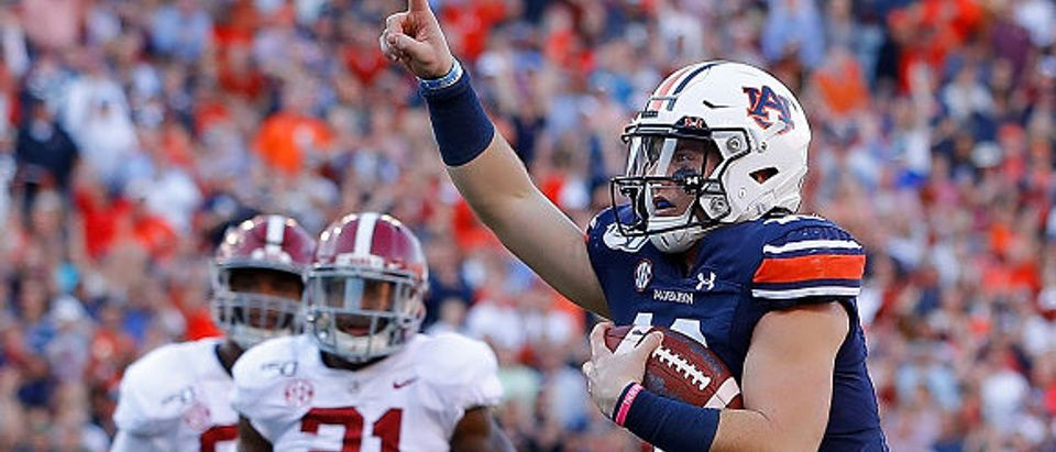 AUBURN, ALABAMA - NOVEMBER 30: Bo Nix #10 of the Auburn Tigers reacts as he rushes for a touchdown against the Alabama Crimson Tide in the first half at Jordan Hare Stadium on November 30, 2019 in Auburn, Alabama. (Photo by Kevin C. Cox/Getty Images)