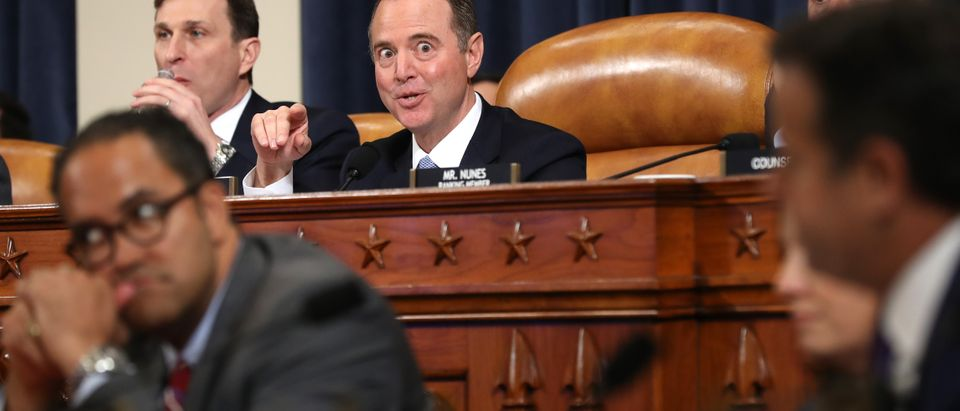 House Intelligence Committee Chairman Adam Schiff (D-CA) referees members as they question witnesses during the first day of public hearing in the impeachment inquiry in the Longworth House Office Building on Capitol Hill November 13, 2019 in Washington, DC. In the first public impeachment hearings in more than two decades, House Democrats are trying to build a case that President Donald Trump committed extortion, bribery or coercion by trying to enlist Ukraine to investigate his political rival in exchange for military aide and a White House meeting that Ukraine President Volodymyr Zelensky sought with Trump. (Photo by Chip Somodevilla/Getty Images)
