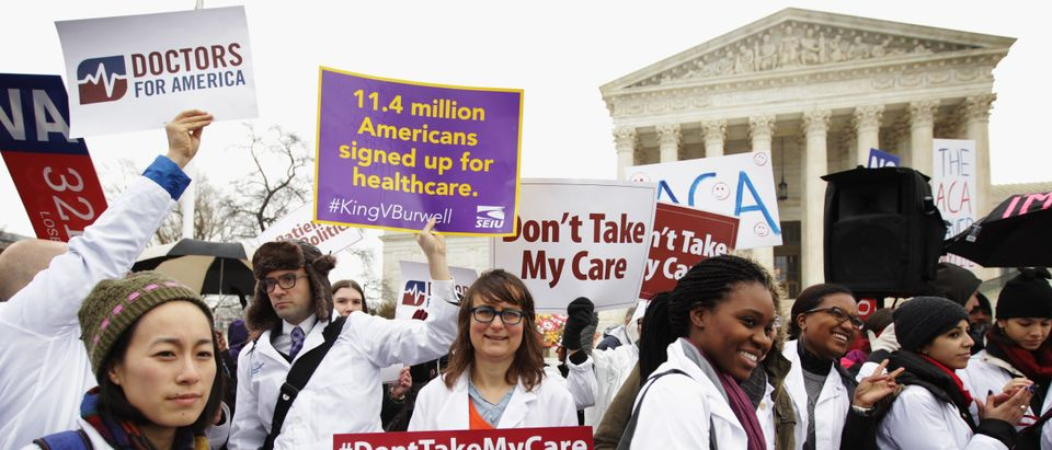 Supporters of the Affordable Care Act gather in front of the Supreme Court on March 4, 2015. (Alex Wong/Getty Images)