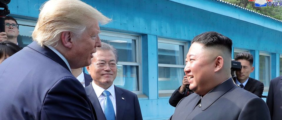 Trump meets with North Korean leader Kim Jong Un at DMZ on border of North and South Korea