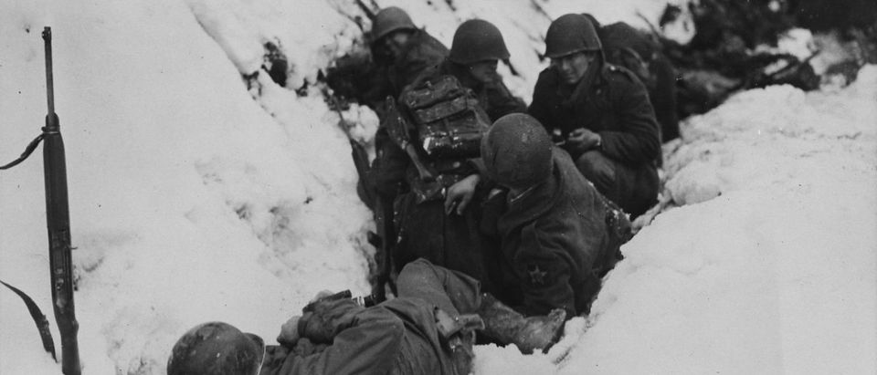 Battle of the Bulge (Credit: Wiki Commons/Public Domain/ U.S. Army https://commons.wikimedia.org/wiki/Category:Battle_of_the_Bulge#/media/File:US_soldiers_take_cover_under_fire_in_Germany_23-0469M.JPG)