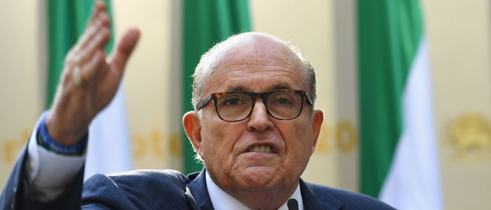 """Rudy Giuliani, Former Mayor of New York City speaks to the Organization of Iranian American Communities during their march to urge """"recognition of the Iranian people's right for regime change. (ANGELA WEISS/AFP via Getty Images)"""