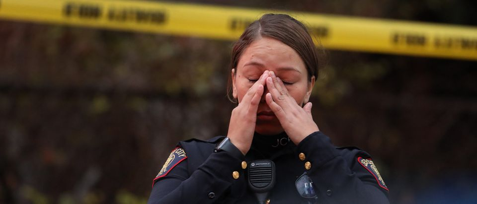 A Jersey City police officer reacts at the scene of a shooting that left multiple people dead on December 10, 2019 in Jersey City, New Jersey. (Rick Loomis/Getty Images)