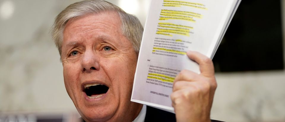 Senate Judiciary Committee Chairman Lindsey Graham holds up a copy of the Steel dossier as Michael Horowitz, inspector general for the Justice Department, testifies before the Senate Judiciary Committee in the Hart Senate Office Building on Dec. 11, 2019 in Washington, D.C. (Win McNamee/Getty Images)