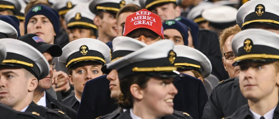 U.S. President Donald Trump watches the game with members of the Navy during the Army-Navy football game in Philadelphia, Pennsylvania, on Dec. 14, 2019. (ANDREW CABALLERO-REYNOLDS/AFP via Getty Images)