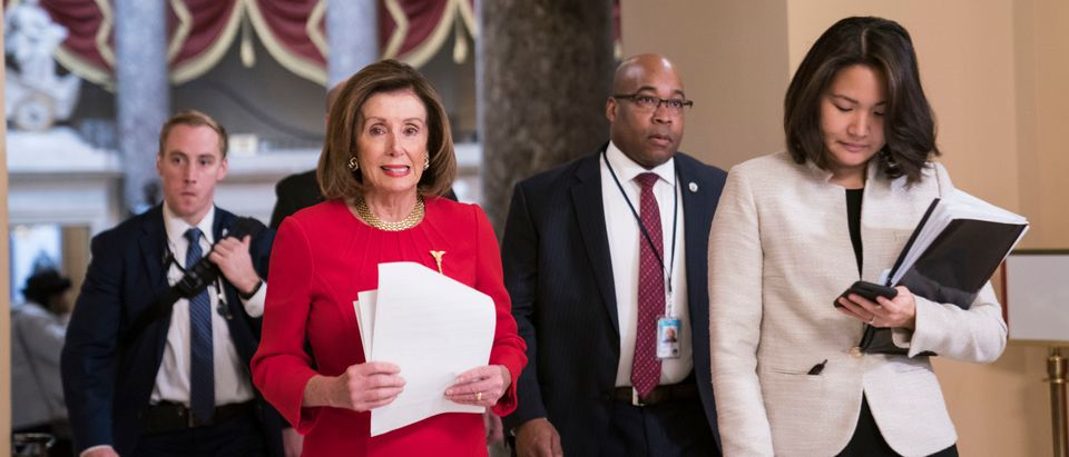 Speaker of the House Nancy Pelosi (D-CA) walks from her office in the U.S. Capitol to the House floor where members debate the United States-Mexico-Canada Agreement (USMCA) on December 19, 2019. (Sarah Silbiger/Getty Images)