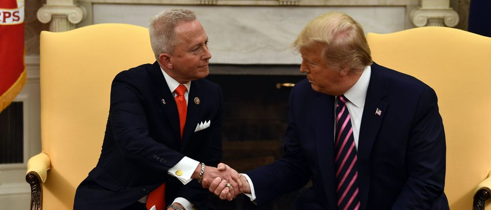US President Donald Trump(R) shakes hands as he meets with Rep. Jeff Van Drew in the Oval Office at the White House on December 19, 2019 in Washington,DC. (BRENDAN SMIALOWSKI/AFP via Getty Images)