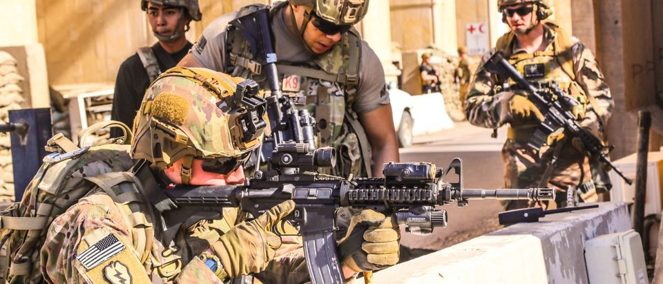 A handout picture received from the US embassy in Iraq on December 31, 2019, shows American soldiers taking position around the embassy in the capital Baghdad, after supporters and members of the Hashed al-Shaabi military network breached the outer wall of the diplomatic mission during a rally to vent anger over weekend air strikes that killed pro-Iran fighters in western Iraq. (US EMBASSY IN IRAQ/AFP via Getty Images)
