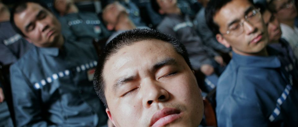 Inmates receive a psychological correctional treatment during a psychological training and consultation session at Qingpu Prison on April 8, 2005 in Shanghai, China. (Photo by China Photos/Getty Images)