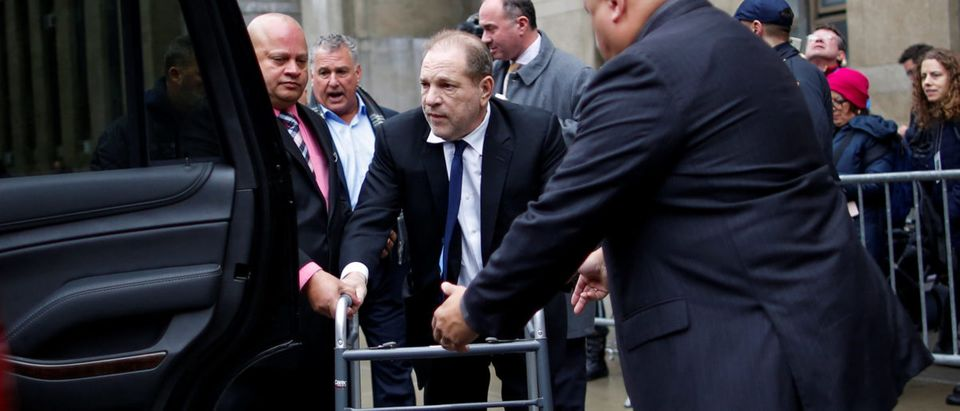 Film producer Weinstein arrives to his car after leaving the the New York Supreme Court in New York