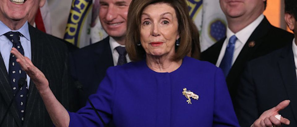 House Speaker Nancy Pelosi (D-CA) and Ways and Means Committee Chairman Richard E. Neal (D-MA) (L), speak during a news conference on the USMCA