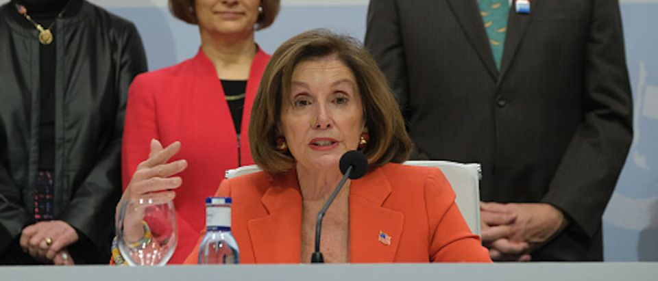 House Speaker Nancy Pelosi (seated) and members of a U.S. Congressional delegation speak to the media while visiting the opening day of the UNFCCC COP25 climate conference on December 2, 2019 in Madrid, Spain