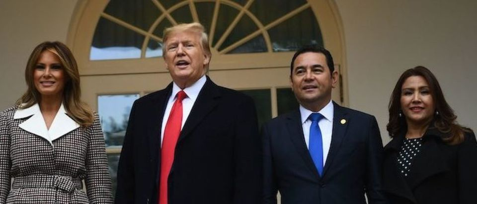 US President Donald Trump and First Lady Melania Trump(L) participate in the arrival of Guatemala's President Jimmy Morales(2ndR) and his wife Marroquin Argueta de Morales at the White House on December 17, 2019 in Washington,DC. (Photo by BRENDAN SMIALOWSKI/AFP via Getty Images)