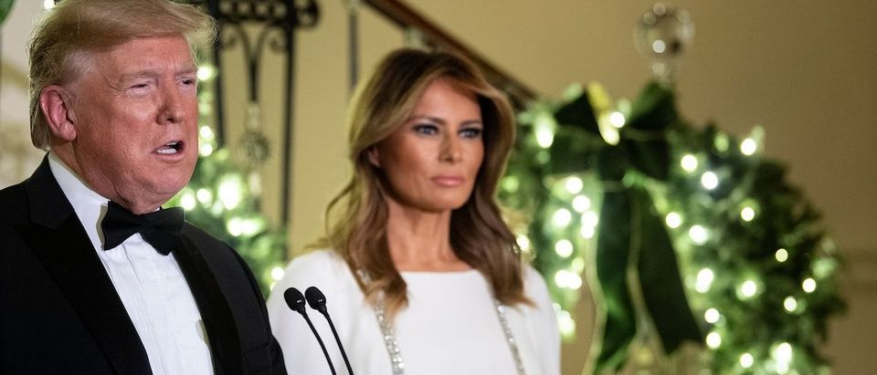 US First Lady Melania Trump listens as US President Donald Trump speaks during the Congressional Ball in the Grand Foyer of the White House on December 12, 2019, in Washington, DC. (Photo by BRENDAN SMIALOWSKI/AFP via Getty Images)