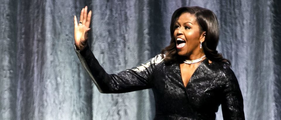 "Former U.S. first lady Michelle Obama gestures as he stands on stage to speak about her autobiography ""Becoming"" at the Ziggo Dome in Amsterdam on April 17, 2019. (Photo: REMKO DE WAAL/AFP via Getty Images)"
