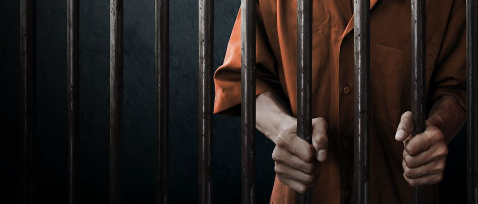 A man in prison is pictured. Shutterstock