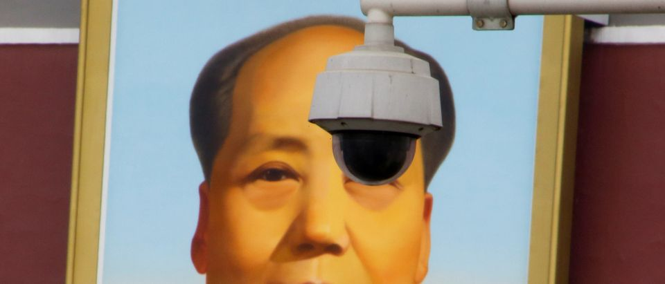 Security camera overlooks Tiananmen Square in front of a portrait of Mao in Beijing