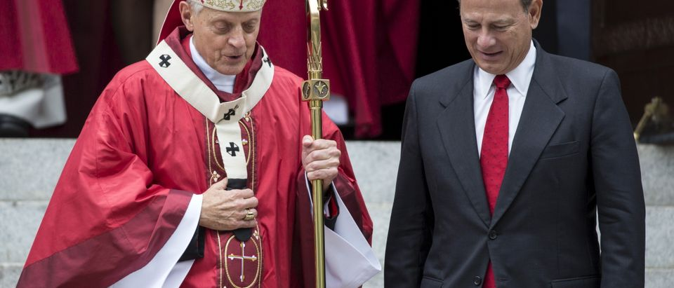 Chief Justice John Roberts speaks with Donald Cardinal Wuerl as he departs from the Cathedral of St. Matthew the Apostle on October 4, 2015. (Reuters/Joshua Roberts)
