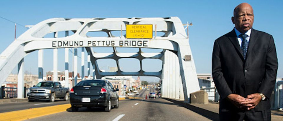 Rep. John Lewis, D-Ga., stands on the Edmund Pettus Bridge in Selma, Ala., in between television interviews on Feb. 14, 2015