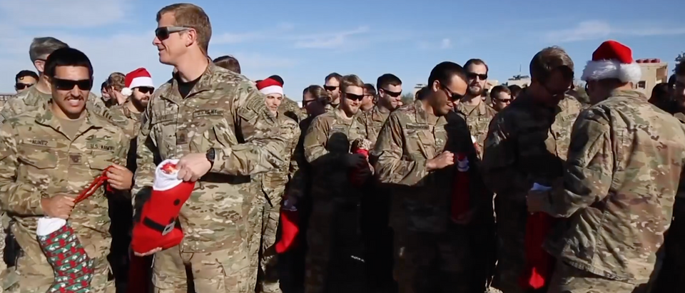 """American troops got presents in Syria because of """"Operation Holiday Express."""" (YouTube/Screenshot/Public — User: VOA)"""