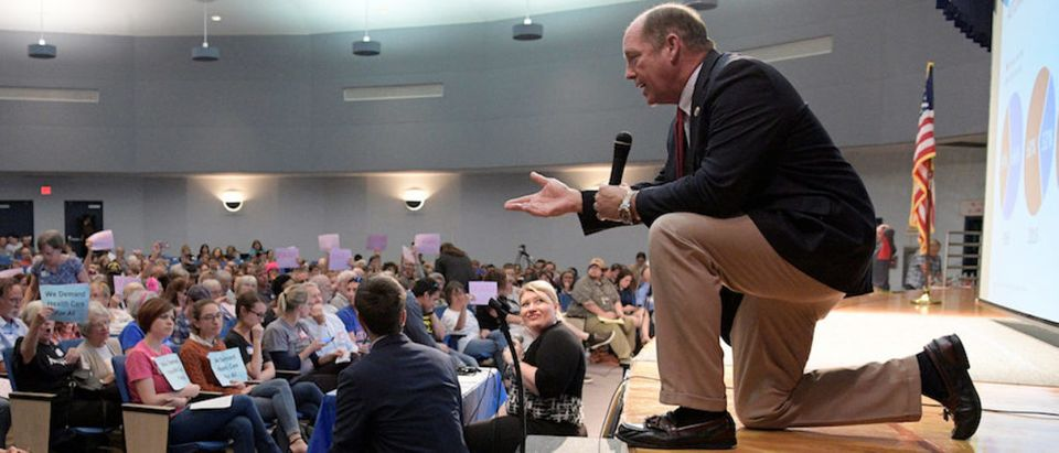 U.S. Representative Ted Yoho answers a question during a town hall meeting in Gainesville
