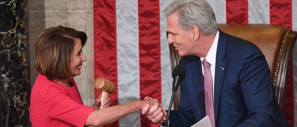 Incoming House Speaker Nancy Pelosi shakes hands with Minority Leader Kevin McCarthy. (SAUL LOEB/AFP via Getty Images)