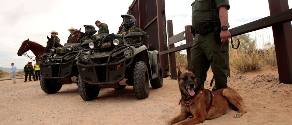 Border Patrol agents keep watch during the official start for the construction of new bollard wall to replace 20-miles of primary vehicle barriers in Santa Teresa