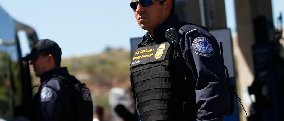 A United States Customs Border Patrol agent waits to inspect vehicles at the U.S. and Mexico Mariposa Port of Entry in Nogales, Arizona, Oct. 8, 2010. REUTERS/Joshua Lott